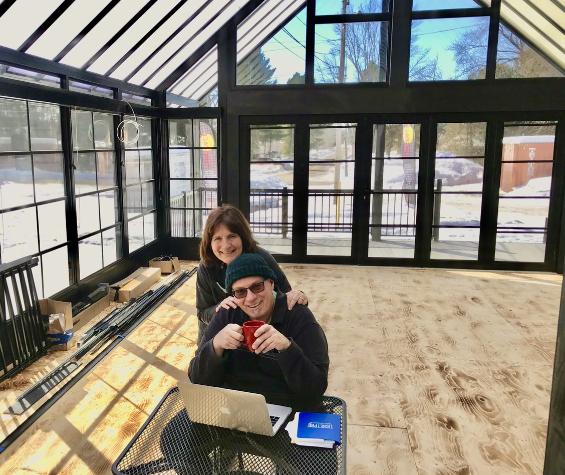 Shawn and Elli have coffee and conversation as they plan for occupying the new Sunspace Sunroom at the back of the Dominion Hotel.