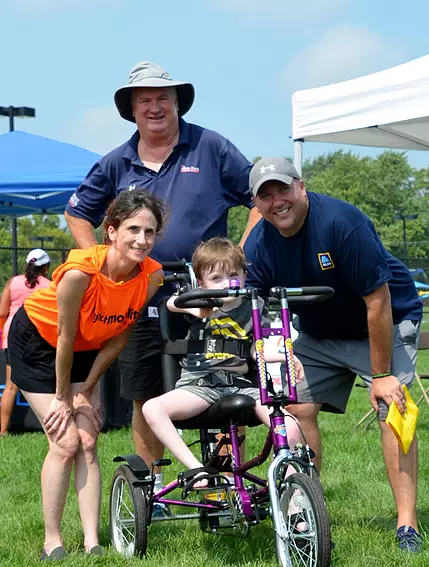 Hal and A happy family with their adaptive bike