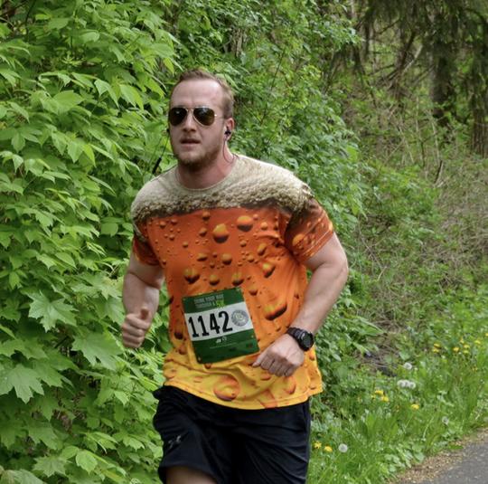 Man running in Beer Jersey