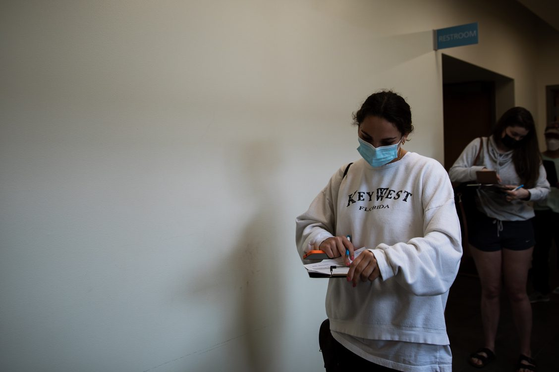 Students study in masks next to Alpine Bagel Cafe