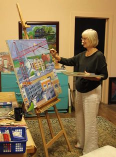 Dortha working on an oil painting project
