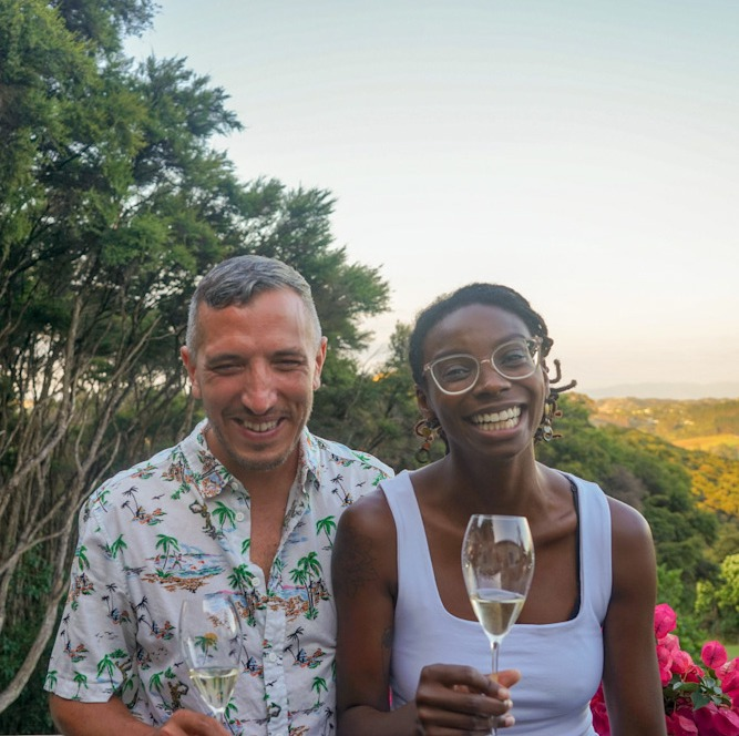Diana and Frank Laughing with glasses of sparkling wine