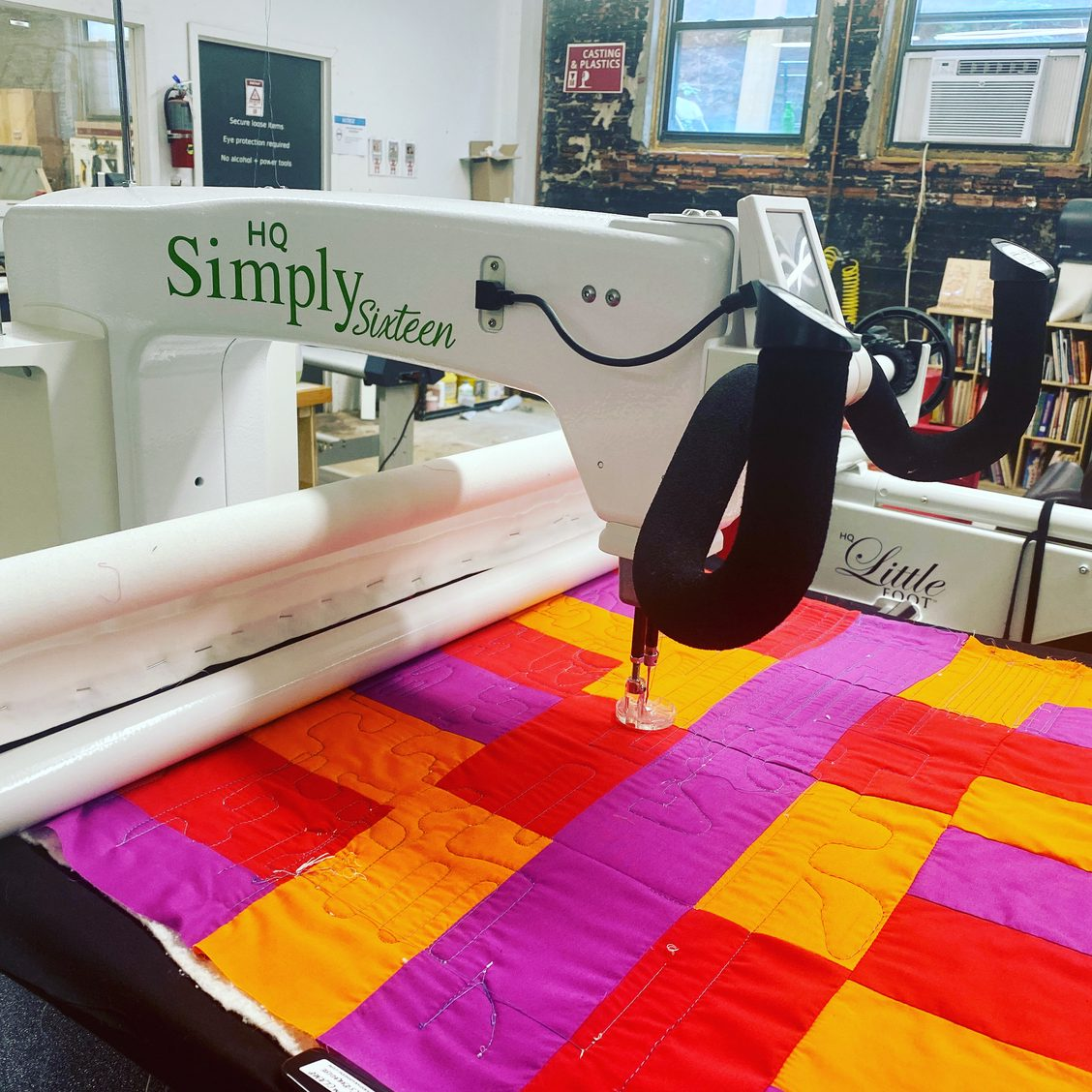 Long arm quilter machine